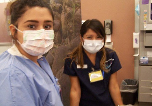 Two dental assistant trainees with face masks