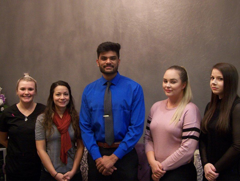 Five dental assisting school students