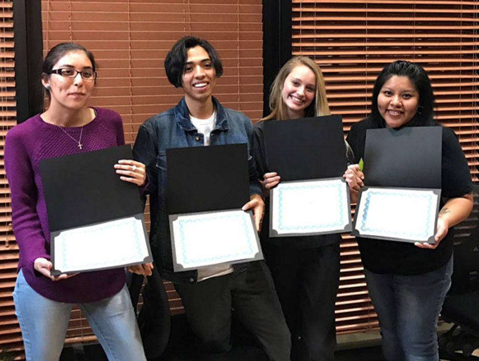 Four dental assisting school students with certificates