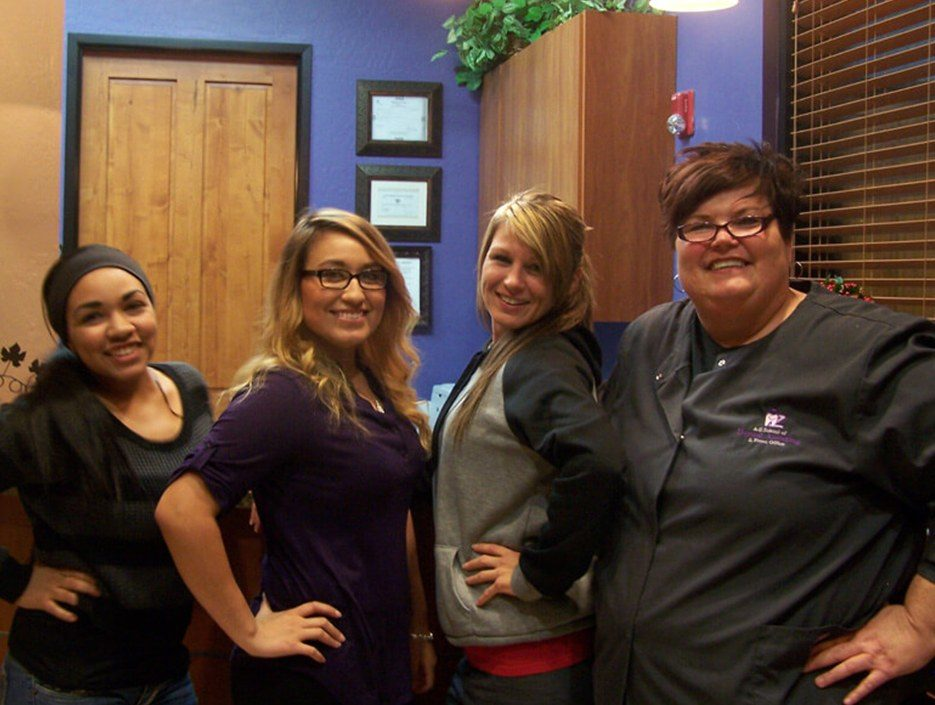 Four dental assisting trainees in the school building