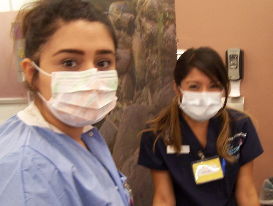Two dental assisting school students with face masks