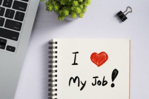 "notepad that reads ""I love my job"""