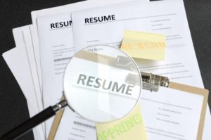 employer looking through dental assistant resumes