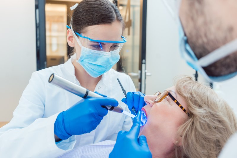 Dental assistant wearing PPE during appointment